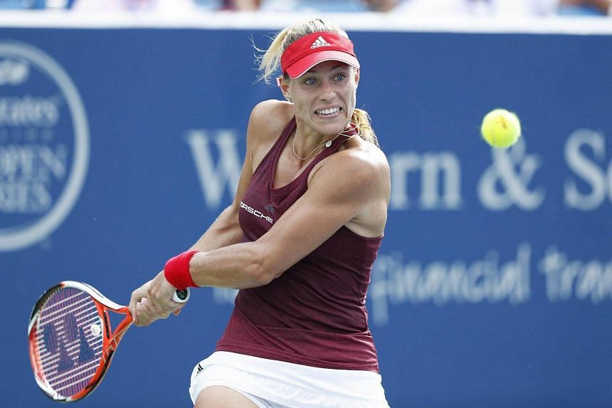 Angelique Kerber hits a return shot to Simona Halep during their semi-final match at Cincinnati.