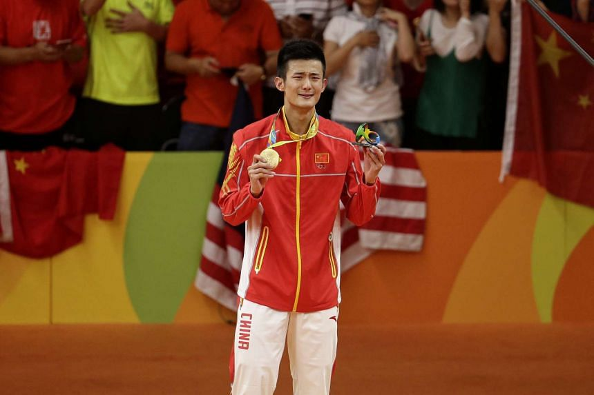 Chen Long breaks into tears after receiving his gold medal.
