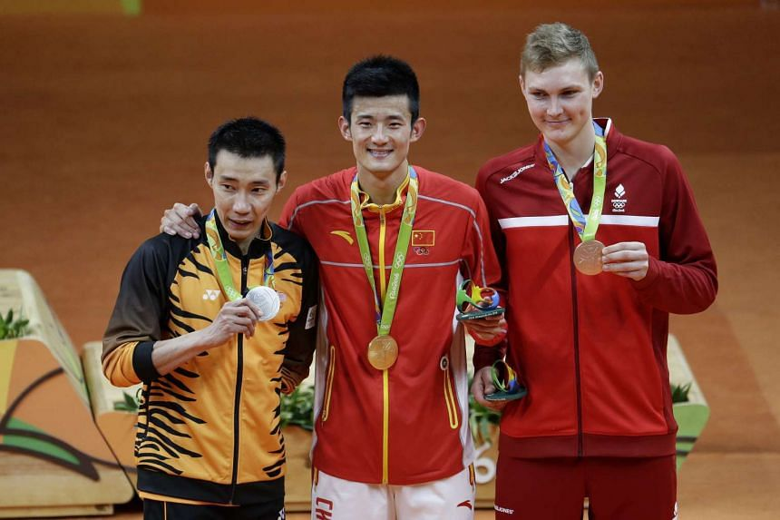 (From left) Silver medalist Lee Chong Wei of Malaysia, gold medalist Chen Long of China and bronze medalist Viktor Axelsen of Denmark on the podium.