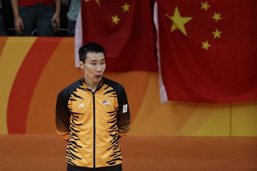 Lee Chong Wei of Malaysia waiting to receive his silver medal.