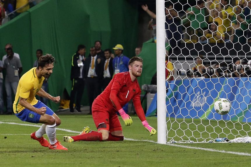 Brazil's Rodrigo Caio (left) celebrating as Neymar's free kick beat Germany's goalkeeper Timo Horn for a 1-0 lead at halftime on Aug 20.
