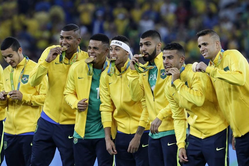 Brazil's football team celebrate after winning gold at the 2016 Rio Olympics on Aug 20.