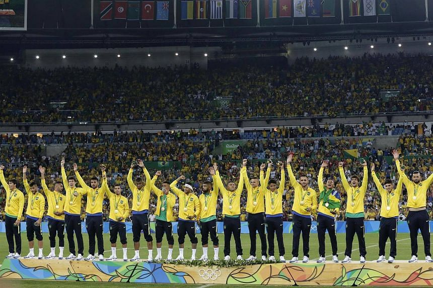 Brazil on the podium with their gold medals after defeating Germany in the football men's gold medal match at the Maracana.