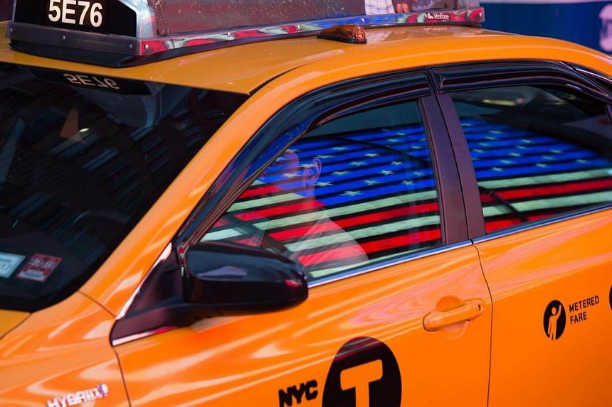 The American flag is reflected on a taxi in Times Square on Memorial Day, May 30 in New York.