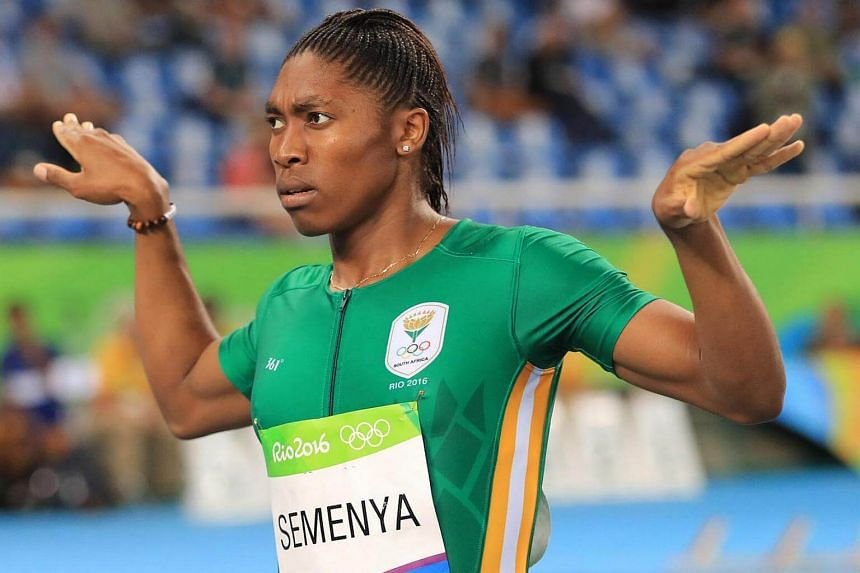 South Africa's Caster Semenya strikes a celebratory pose after cruising to victory in the women's 800m.