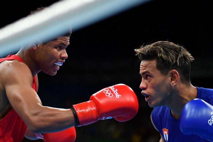 Cuba's Robeisy Ramirez (blue) in action against the US' Shakur Stevenson.