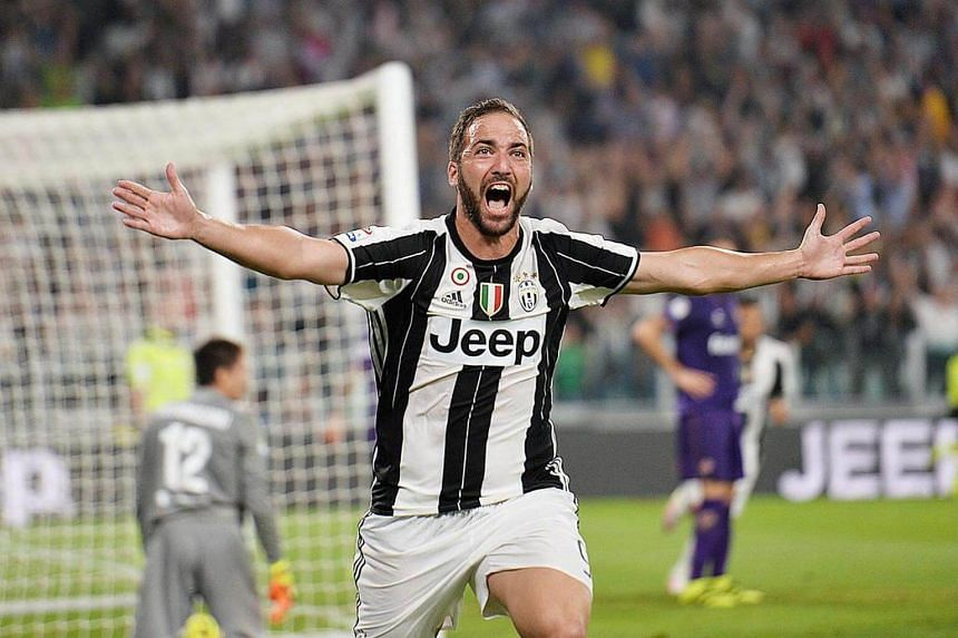 Juventus' Gonzalo Higuain celebrates after scoring the winner against Fiorentina in a 2-1 win.
