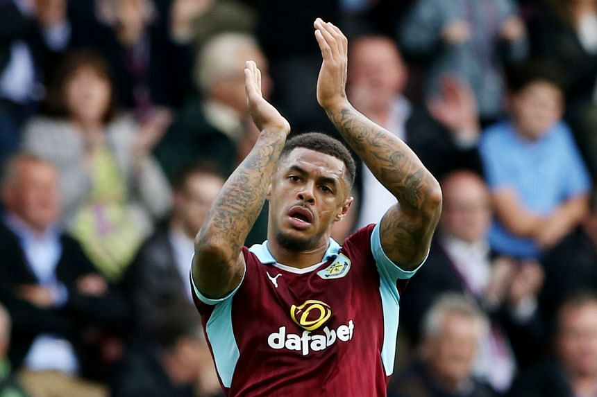 Burnley's Andre Gray applauds the fans.