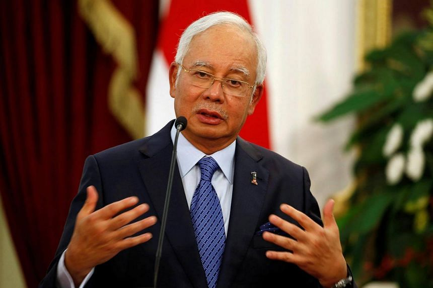 Malaysia's Prime Minister Najib Razak talks to the media at the Presidential Palace in Jakarta, Indonesia on August 1.