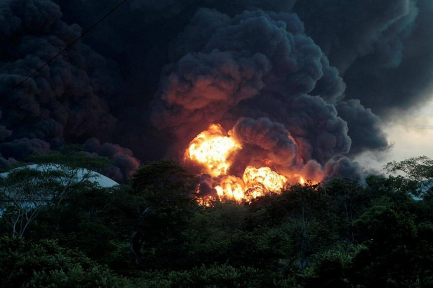 An explosion caused by a fire at a fuel storage tank belonging to the Puma Energy Company is seen in Puerto Sandino, Leon, Nicaragua on August 18.