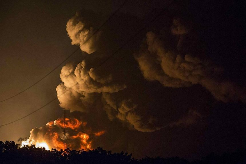 Smoke rises from a fire at a Puma Energy plant after two oil tanks exploded in Puerto Sandino near Managua, Nicaragua on August 18.