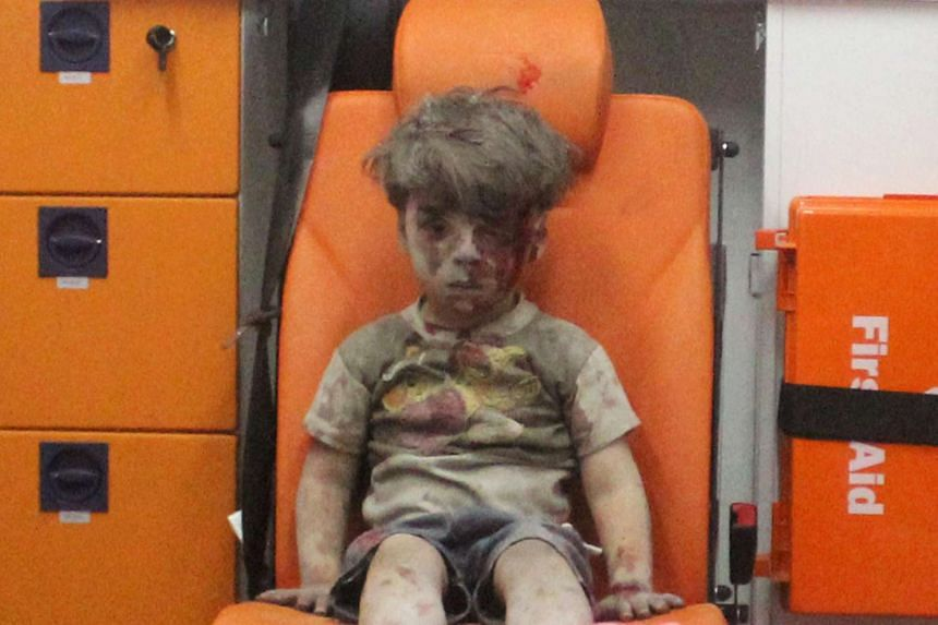 Five-year-old Omran Daqneesh, with bloodied face, sits inside an ambulance after he was rescued on Aug 17, 2016.