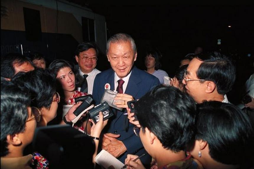 Chua Kim Yeow (centre) being surrounded by the media, after losing to his rival, Mr Ong Teng Cheong, during Singapore's first presidential election in 1993.