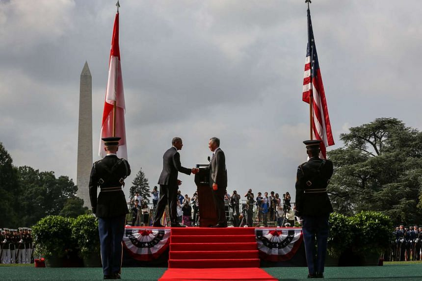 Singapore Prime Minister Lee Hsien Loong and US President Barack Obama at the official welcome ceremony at the White House.