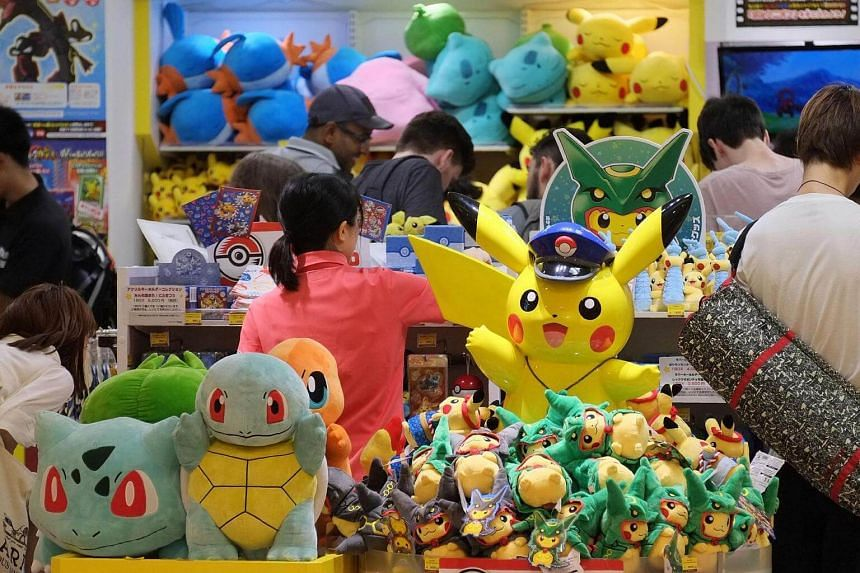 Customers visiting a shop selling Pokemon goods in Tokyo on July 13.