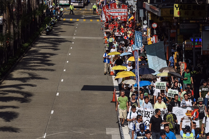 Hundreds of protesters staging a pro-democracy march on Sunday, Aug 21, 2016 to protest against the disqualification of six candidates from next month's Legislative Council (Legco) election.