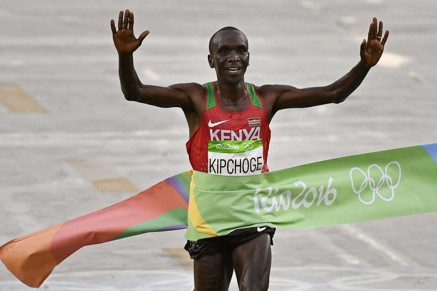 Eliud Kipchoge of Kenya celebrates while crossing the finish line to win the men's Marathon race of the Rio 2016 Olympic Games on Sunday (Aug 21).