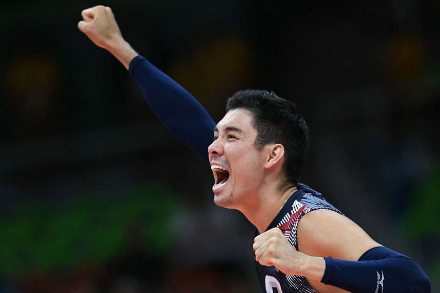 USA's Erik Shoji celebrates after scoring during the men's Bronze Medal volleyball match between USA and Russia on Sunday (Aug 21).