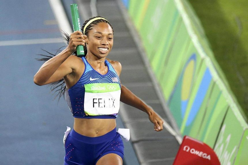 Allyson Felix of the US celebrates winning gold at the 2016 Rio Olympics on Aug 20.