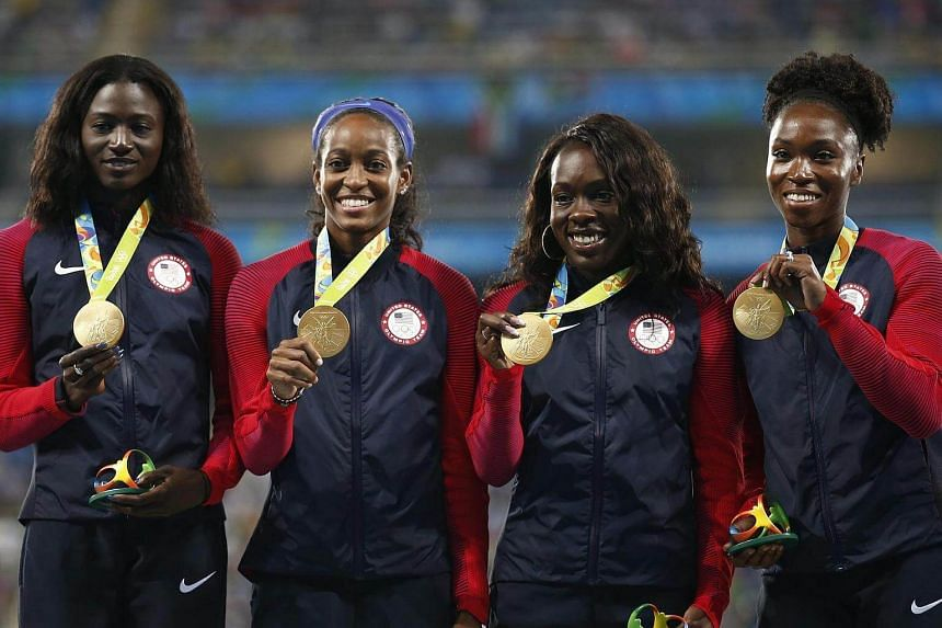 (From left) Tianna Bartoletta, Allyson Felix, English Gardner and Tori Bowie of the USA pose with their gold medals on the podium on Aug 20.