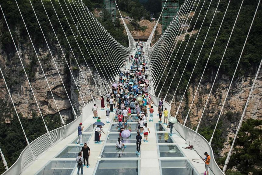 The world's highest and longest glass-bottomed bridge is seen above a valley in Zhangjiajie in China's Hunan Province on Aug 20.