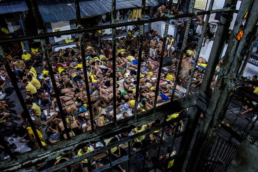 Inmates sleeping at the open basketball court inside the Quezon City jail in Manila on July 21, 2016.