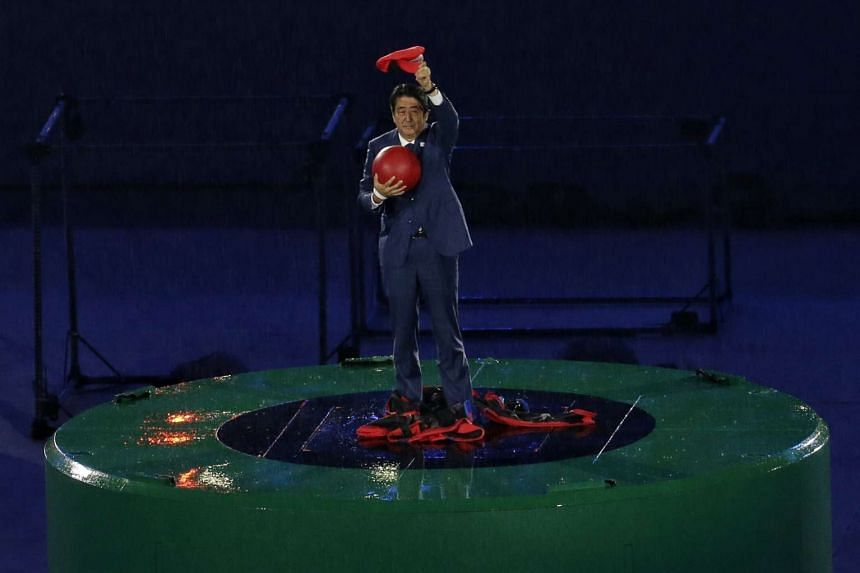 Japanese Prime Minister Shinzo Abe emerging from a green pipe dressed as Super Mario during the closing ceremony of the Rio 2016 Olympic Games on Aug 21, 2016.