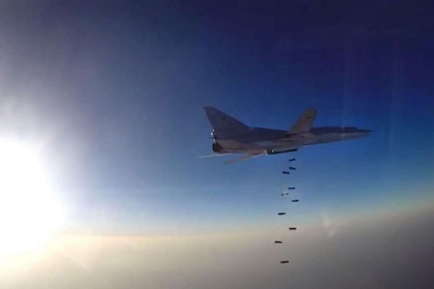 A video grab reportedly showing a Russian bomber Tupolev Tu-22M3 conducting an airstrike.