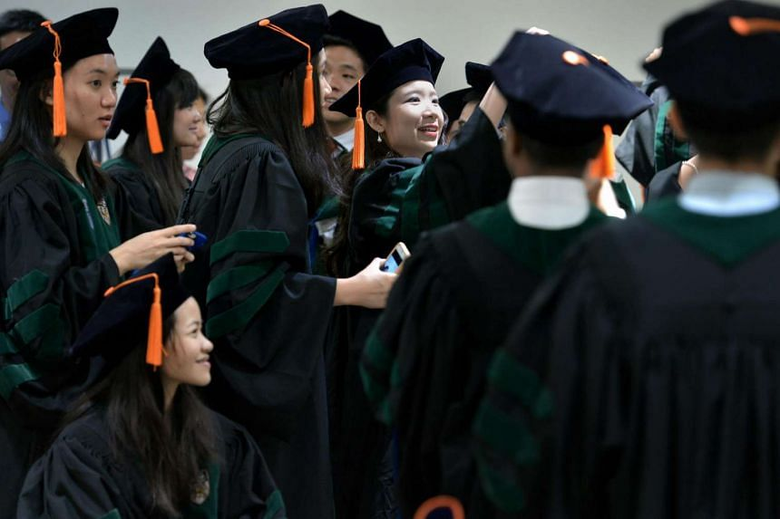 Medical students from Duke-NUS Medical School at their graduation ceremony in 2015.