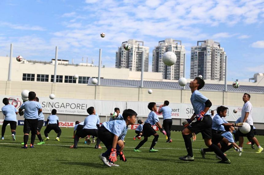 Young goalkeepers going through their paces at the Jalan Besar Stadium on April 16, 2016, under the Goalkeeper Academy of Singapore programme.