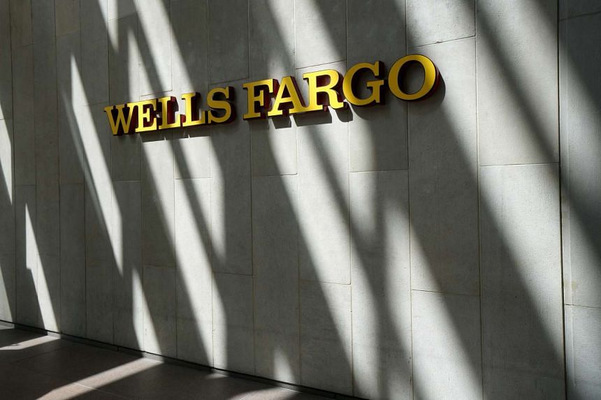 The sign outside the Wells Fargo bank in downtown Denver. US customers are not ready to give up regular visits to their nearest branch.