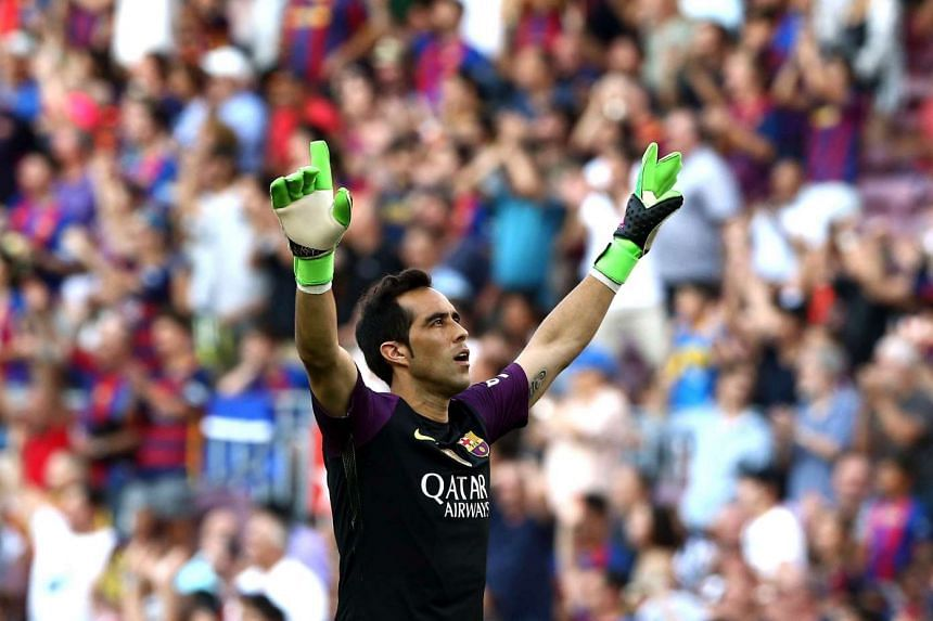 Goalkeeper Claudio Bravo celebrates after Luis Suarez scored the team's second goal against Real Betis on August 20 in the Primera Division.