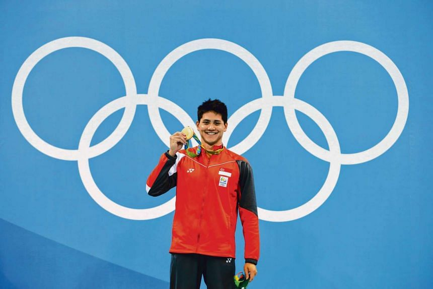 Joseph Schooling of Singapore with the gold medal on the podium after winning the Rio 2016 Olympic Games men's 100m butterfly final at the Olympic Aquatics Stadium in Rio de Janeiro, Brazil, on August 12.