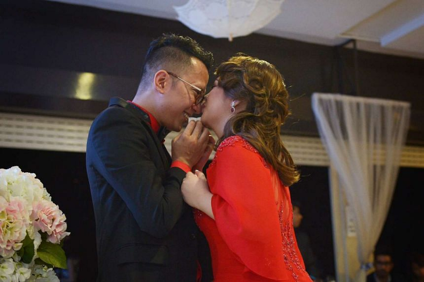 Sezairi Sezali and his wife share a sweet moment during their wedding dinner on Sunday (Aug 21) at the SAF Yacht Club.