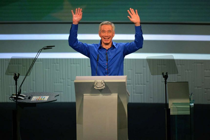 Prime Minister Lee Hsien Loong Waving To The Au Nce After Returning To Finish His Speech