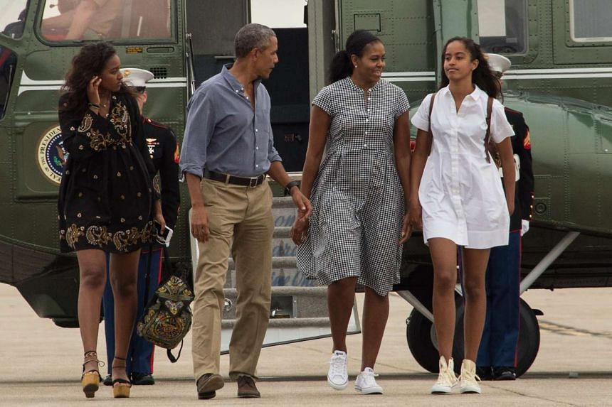 US President Barack Obama and family walk to board Air Force One at Cape Cod Air Force Station in Massachusetts on August 21as they depart for Washington after a two-week holiday at nearby Martha's Vineyard.