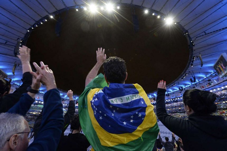 Spectators cheer before the closing ceremony of the Rio 2016 Olympic Games at the Maracana Stadium in Rio de Janeiro, Brazil, August 21.