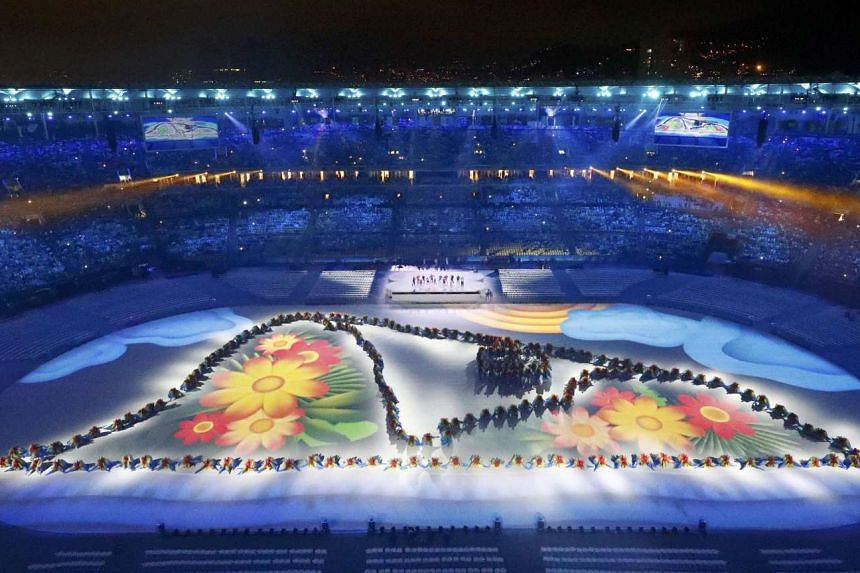 Performers take part in the Rio Olympics closing ceremony.