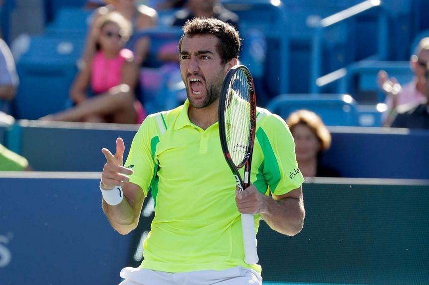 Marin Cilic celebrates after beating Andy Murray in the final match during day 9 of the Western & Southern Open at the Lindner Family Tennis Center on Aug 21.