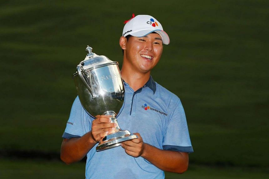 Kim Si Woo poses with the trophy after winning the final round of the Wyndham Championship at Sedgefield Country Club on August 21.
