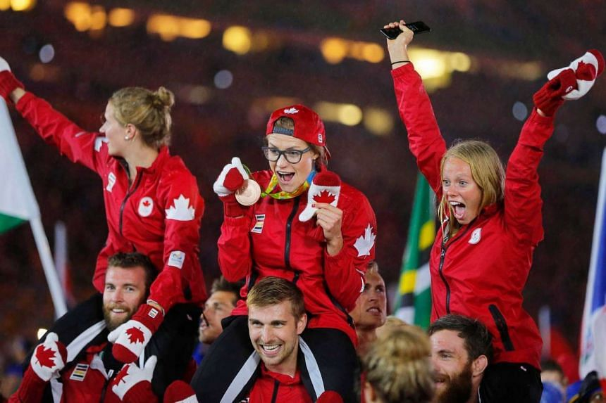 Canadian athletes having some fun during the closing ceremony.