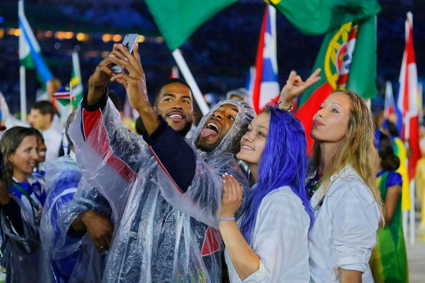 Athletes of the USA take a selfie during the closing ceremony.