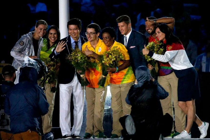 New IOC members, including Russian pole vaulter Yelena Isinbayeva (right), pose for a picture during the closing ceremony.