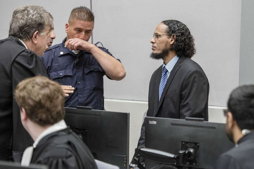 Suspected Islamist militant Ahmad Al Faqi Al Mahdi (right) appearing at the International Criminal Court (ICC) in The Hague, Netherlands, on Aug 22, 2016, at the start of his trial on charges of involvement in the destruction of historic mausoleums i