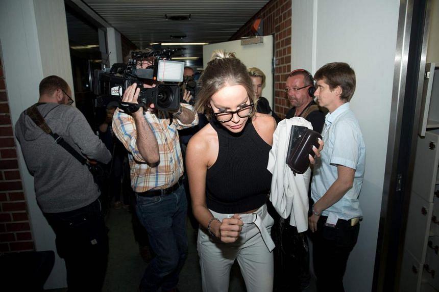 German model Gina-Lisa Lohfink leaves the the District Court of Tiergarten in Berlin, on Aug 22, 2016.