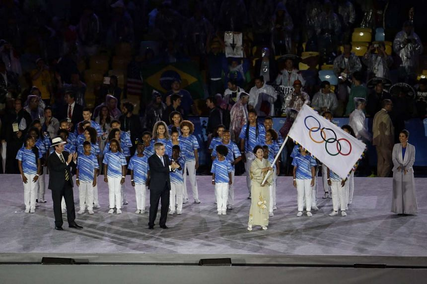 The Olympic flag handed over to Tokyo governor Yuriko Koike during the closing ceremony of the Rio 2016 Olympic Games at the Maracana in Rio de Janeiro, Brazil, on Aug 21, 2016.