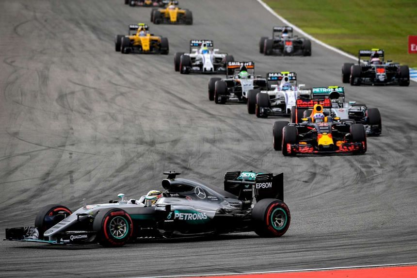British driver Lewis Hamilton leads after the start for the Formula One German Grand Prix on July 31, 2016.