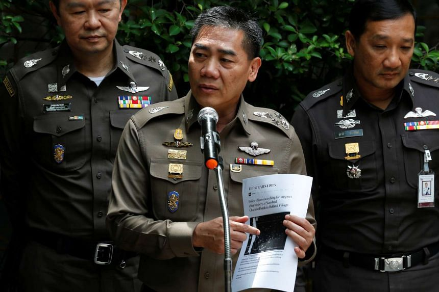 Thailand's national police chief Jakthip Chaijinda (centre) said that police have not ruled out any motive for the attacks.