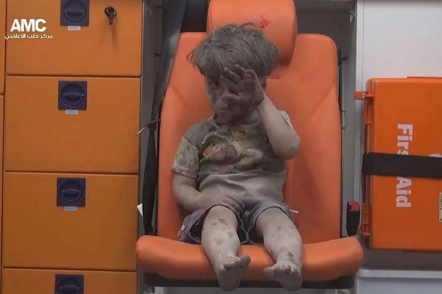 China's state broadcaster has questioned the authenticity of a viral video showing a Syrian boy sitting in an ambulance after an alleged airstrike in Aleppo.