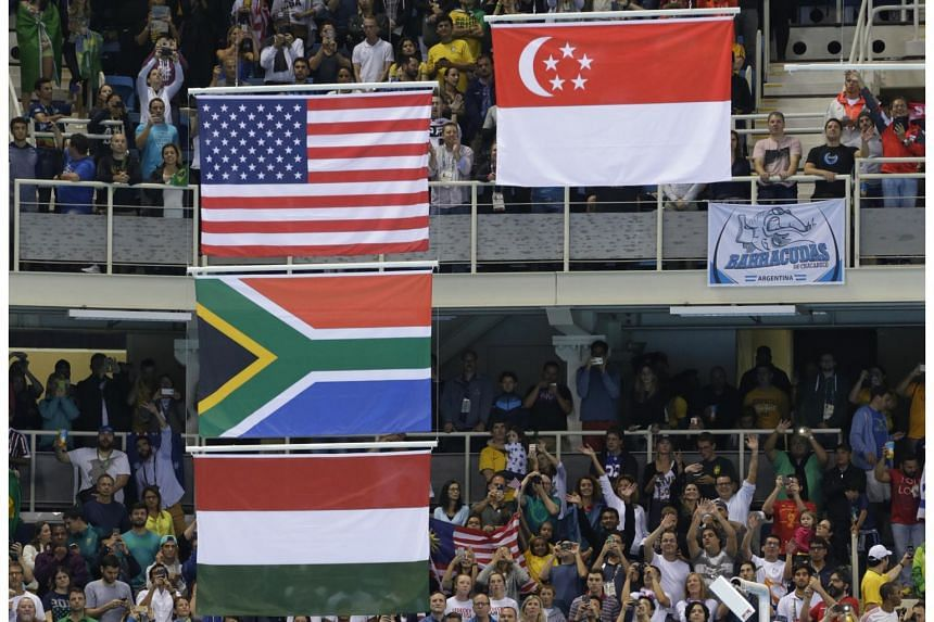 The raising of the Singapore flag during the victory ceremony after Joseph Schooling won the men's 100m butterfly final at the Olympic Aquatics Stadium in Rio de Janeiro on Aug 12, 2016.